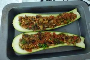 Spoon vegetable mixture into marrow halves