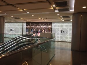 Up the escalator and turn right at Dior