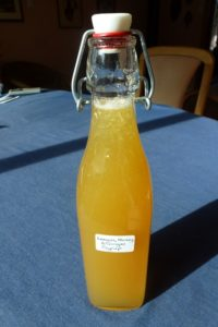 Pour lemon honey ginger syrup into a bottle