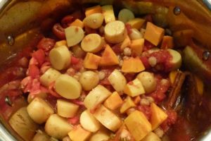 Add chickpeas, saffron, pumpkin, potatoes, and tomatoes