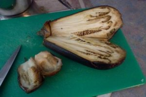 Cut roast eggplant in half