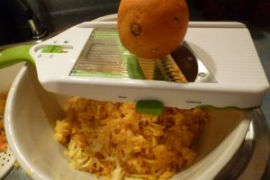 Slice oranges finely