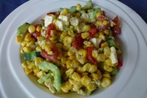 Sweetcorn, tomato, cucumber, capsicum salad with avocado and feta