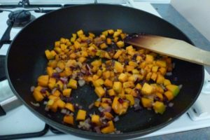 Saute pumpkin and onion