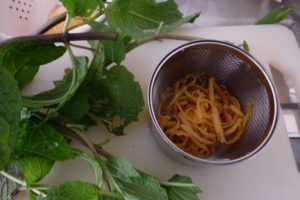 Lemon zest and mint stalks