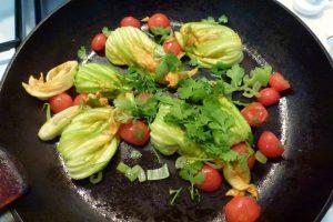 Saute vegetables in pan