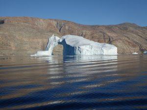 Iceberg arch in the sun