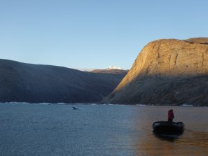 First rays of sun on hills at Ingmikortilaq