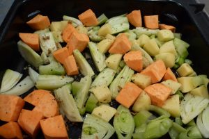 Put vegetables in pan with oil and water