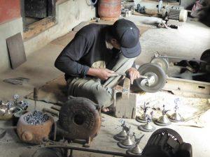 Making traditional brass jug