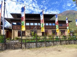 House with Prayer flags