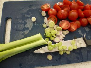 Chop tomatoes, spring onions,
