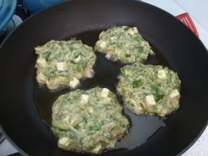 Put in spoonfuls into a pan