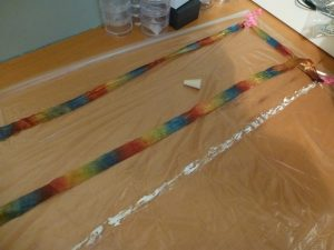 Lay out water soluble film and glue down silk ribbon