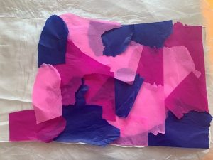 Lay out tissue paper onto scarf